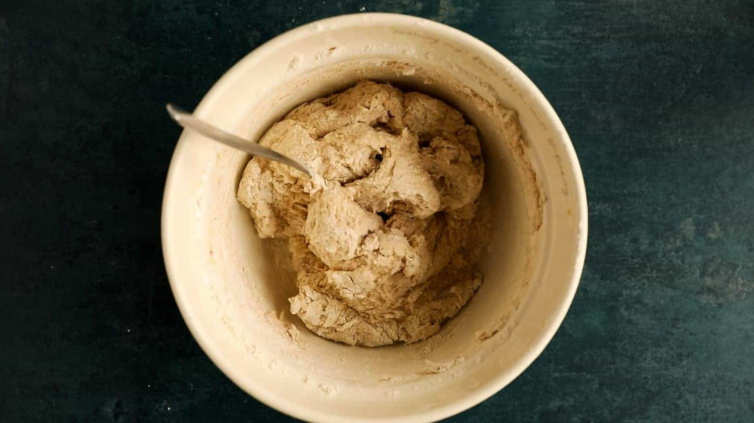 A mixing bowl with dough inside.