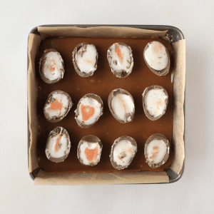 Cadbury's Creme Eggs placed in rows on top of Caramel Shortbread base