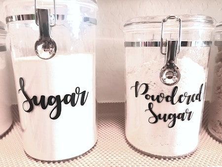 Organize a walk-in pantry: labeled canisters