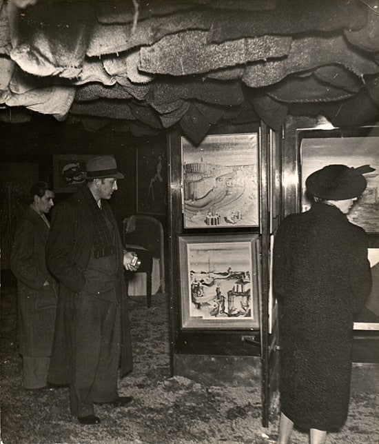 Visitors with flashlights at the International Surrealist Exhibition, Paris, 1938