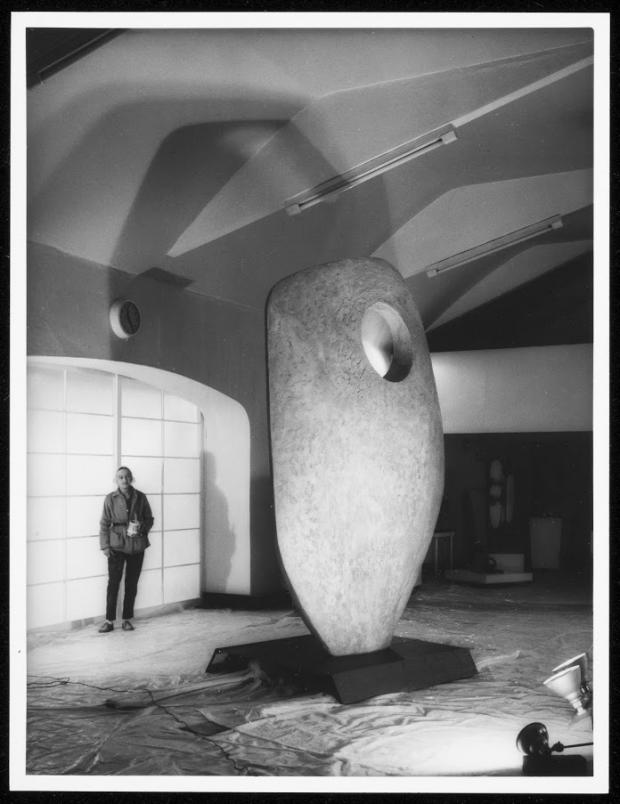 Sculptor Barbara Hepworth with the prototype for Single Form (Memorial) in the Palais de Danse, 1962. Photograph by Studio St Ives. Courtesy Bowness. Barbara Hepworth © Bowness.