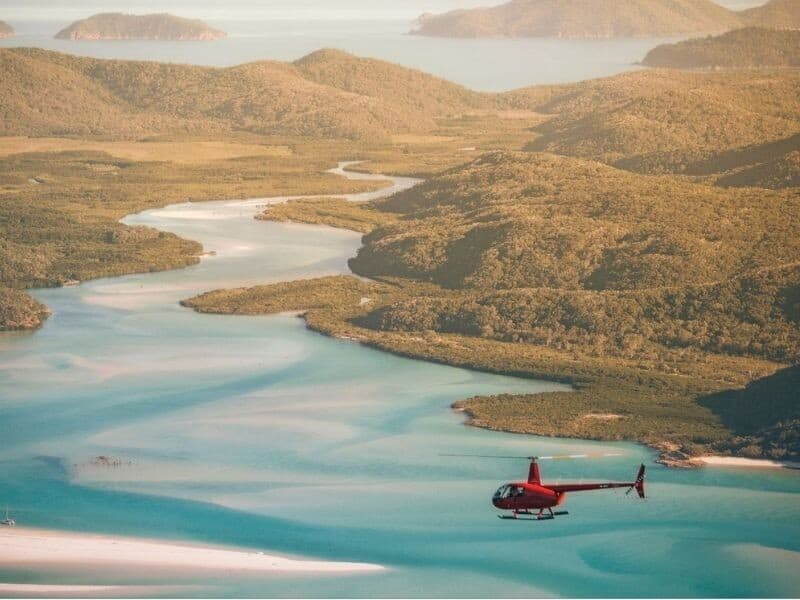 Helicopter flying over Hill Inlet at Whitehaven Beach on Whitsunday Island