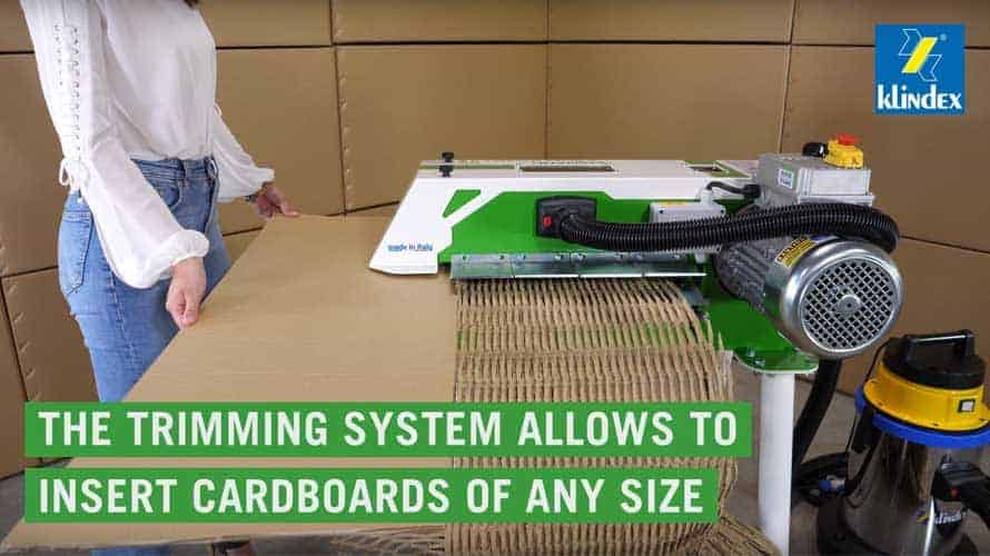 trimming-cardboard-while-converting-it-into-cardboard-packaging