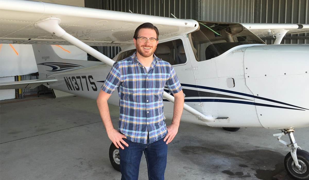 Jason DeCamillis in front of a plane