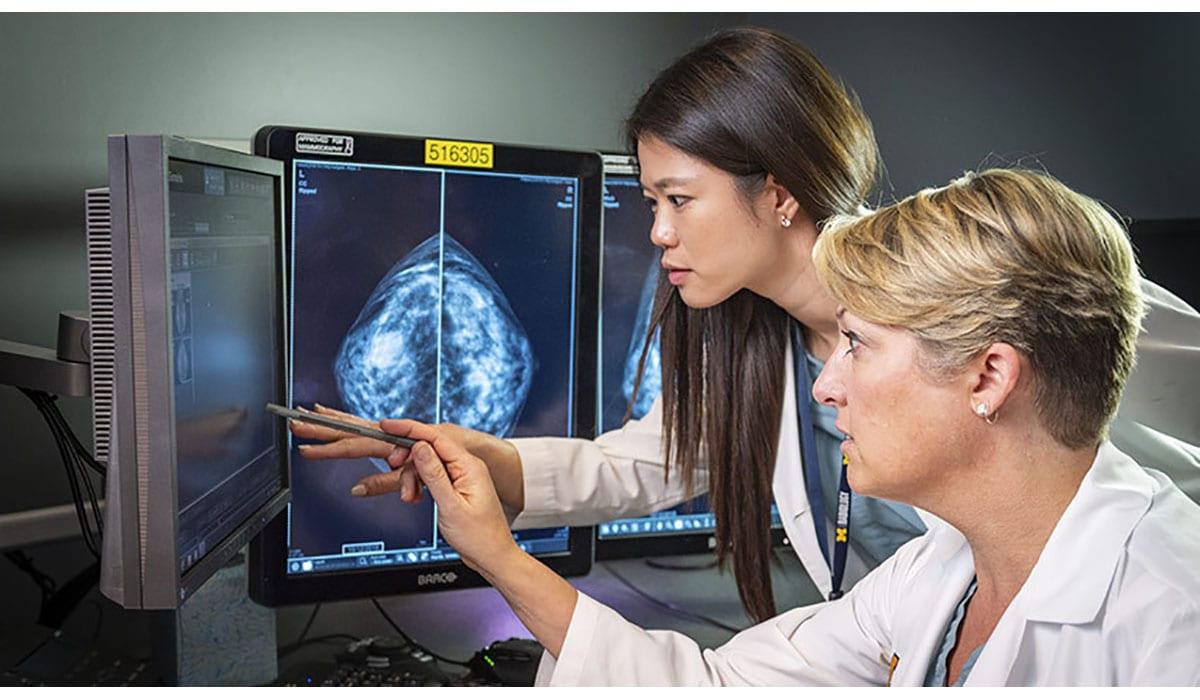 Doctors Pointing Computer Scan Mammogram Gatewayextension