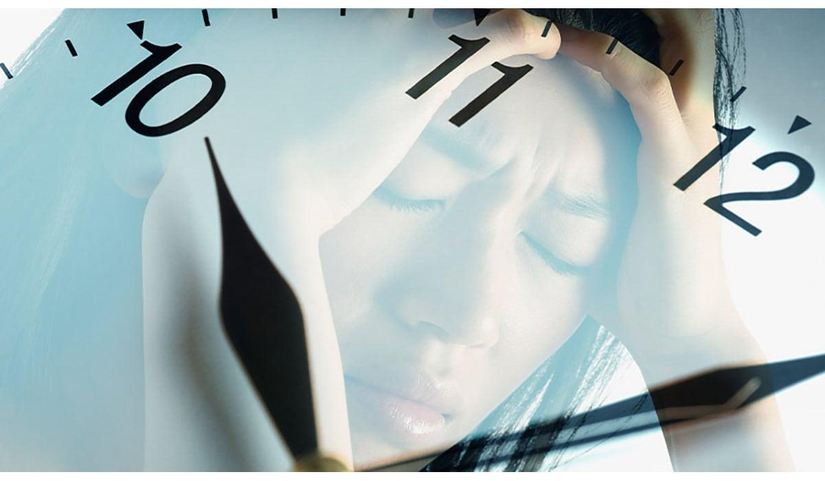 Woman Reflected In Clock Holding Head In Pain Gatewayextension