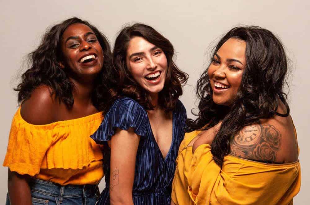 Group of three girls smiling