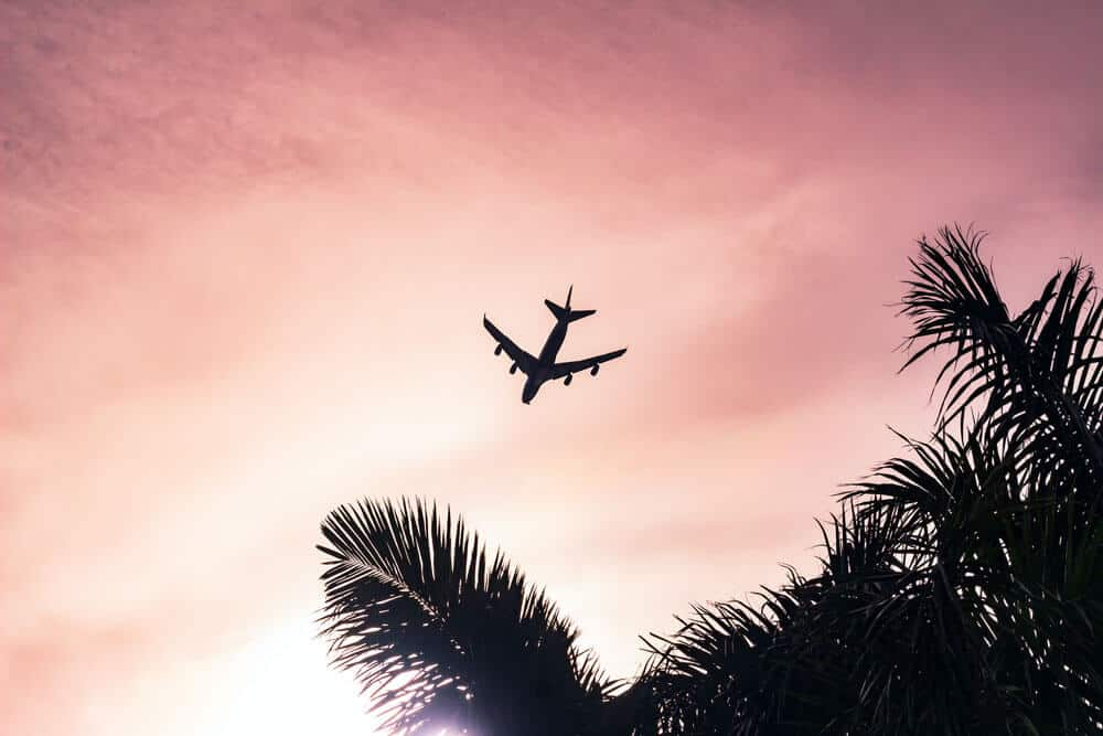pink sky with aeroplane silhouette