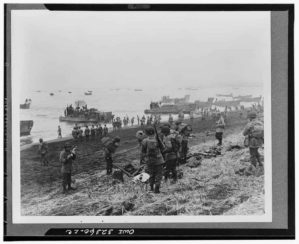 This negative captures US soldiers landing at  Massacre Bay on Attu Island on May 11, 1943.  Source: Library of Congress.