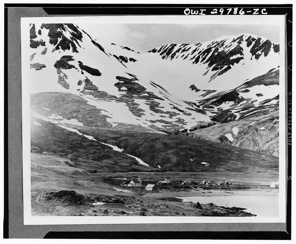 This 1937 negative by O.J. Murie shows the Attu Village in Chichagof harbour.  Source: Library of Congress.