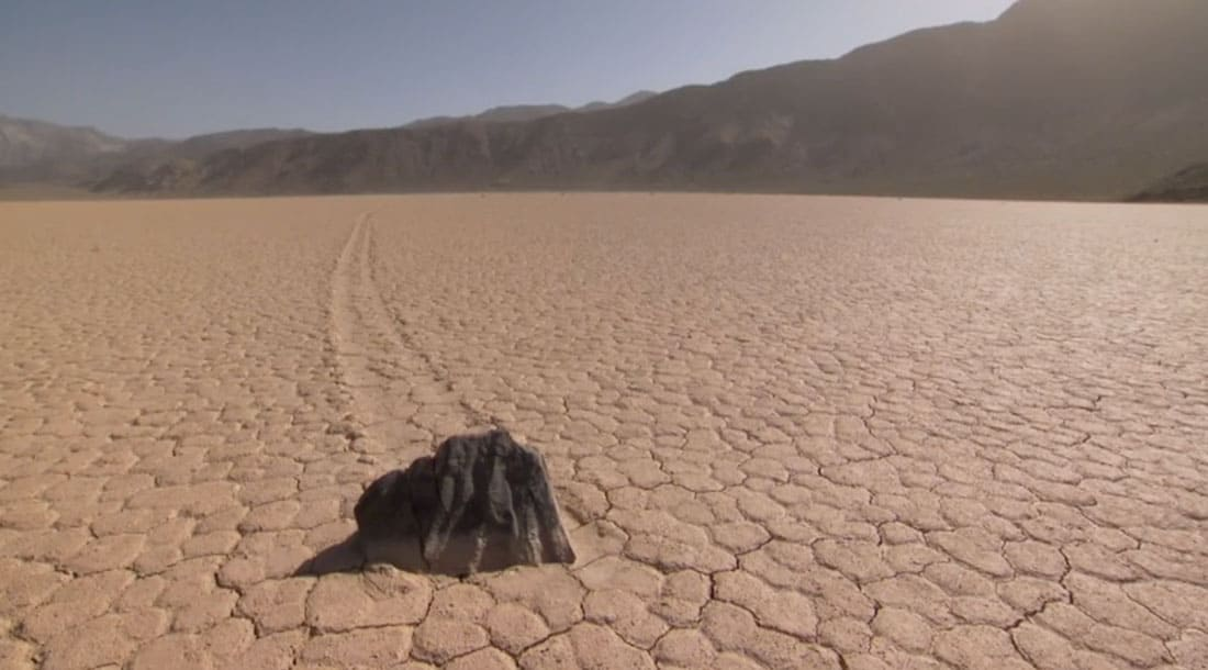 A boulder moving along the dry lake bed.  Racetrack, Death Valley.  Photo: NPS.
