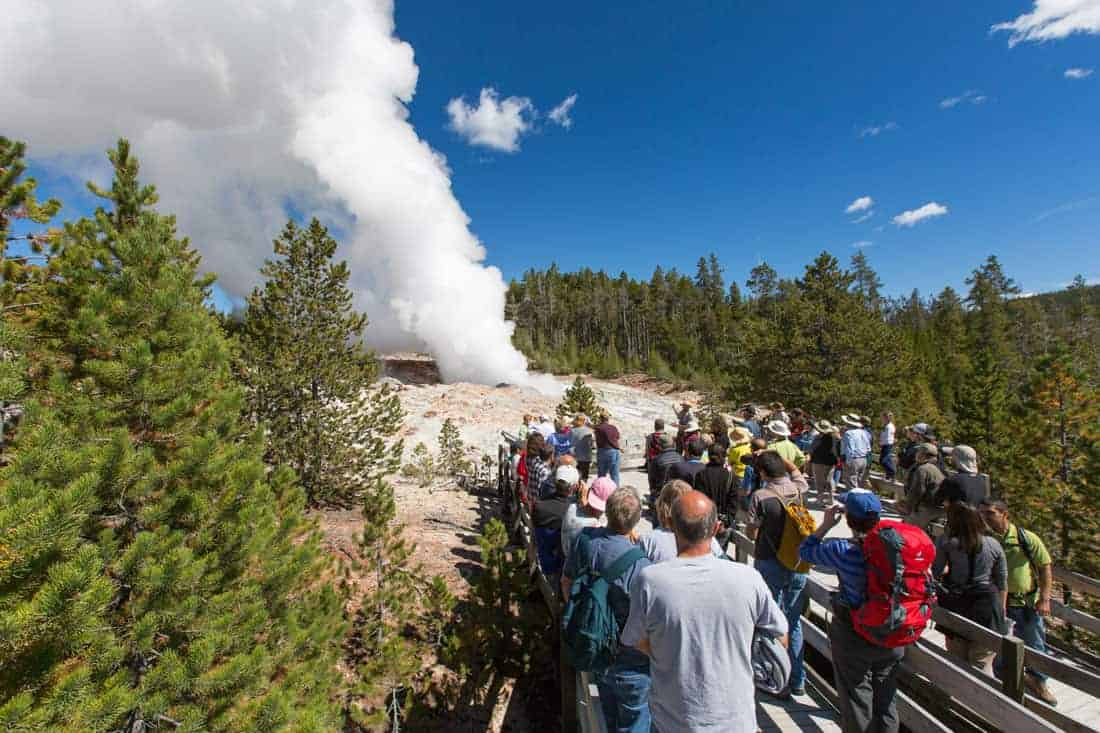 Tourist watch steam vent from Steamboat Geyser on Setpmber 4, 2014, the day after it erupted. Photo: Neal Herbert/NPS, public domain.