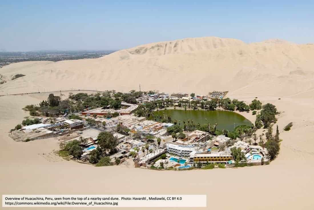Overview of Huacachina, Peru, seen from the top of a nearby sand dune. Photo: Havardtl , Mediawiki, CC BY 4.0