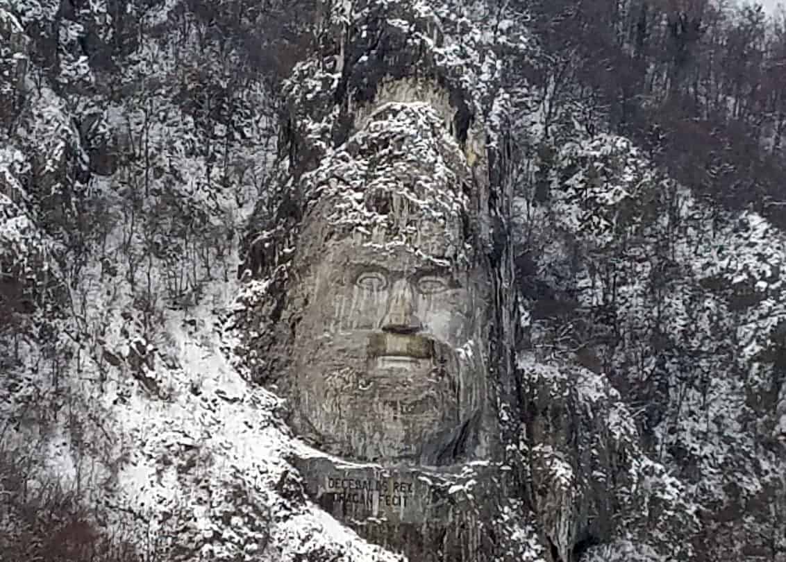 Rock carving, on the Romanian side of the Danube River, depicting the Dacian King Decebalus (r. A.D. 87-106), who fought the Romans in the early 2nd century but was ultimately defeated. He is considered a Romanian national hero. The carving, made between 1994 and 2004, is 42.9 m (141 ft) tall and 31.6 m (104 ft) wide and is the tallest rock relief in Europe. Photo: CIA, public domain.