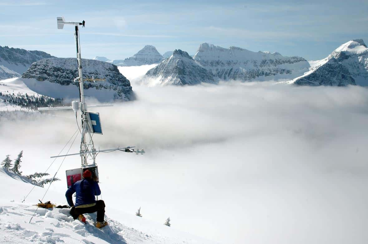 A weather station adjacent to the Haystack Creek avalanche path in Glacier National Park. Weather stations are used to measure wind speed and direction, air temperature, relative humidity, and net radiation measurements. Photo: Suzanna Soileau, USGS. Public domain
