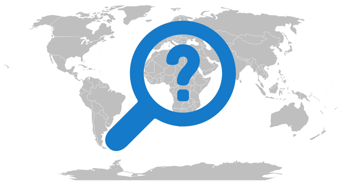 Grayscale map of the world with a question mark inside of a magnifying glass.