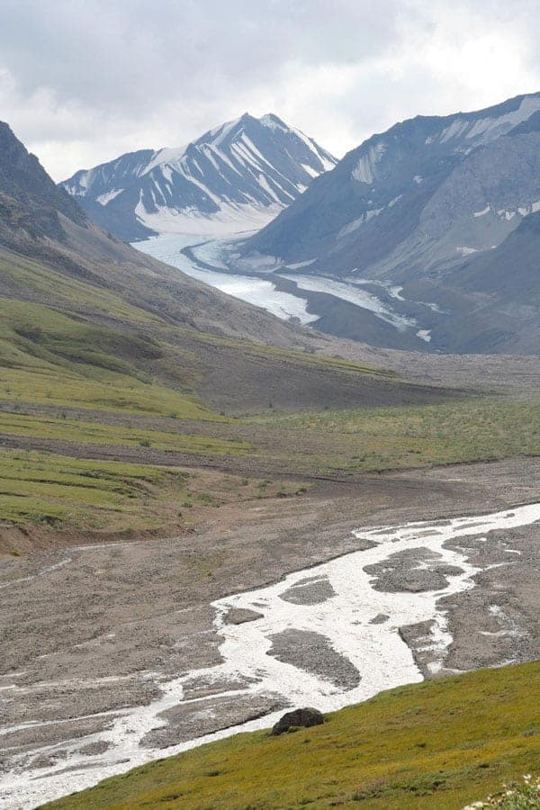 Retreating glacier south of Mt. Pendleton in Denali National Park, Alaska, with runoff from glacial melt seen in the foreground. Photo: Dennis G. Dye, U.S. Geological Survey. Public domain.