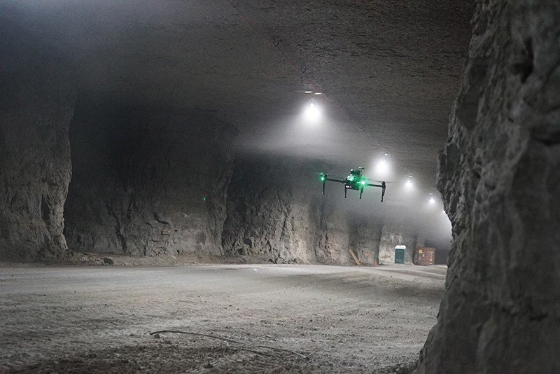 Image of an autonomous drone flying in a tunnel.