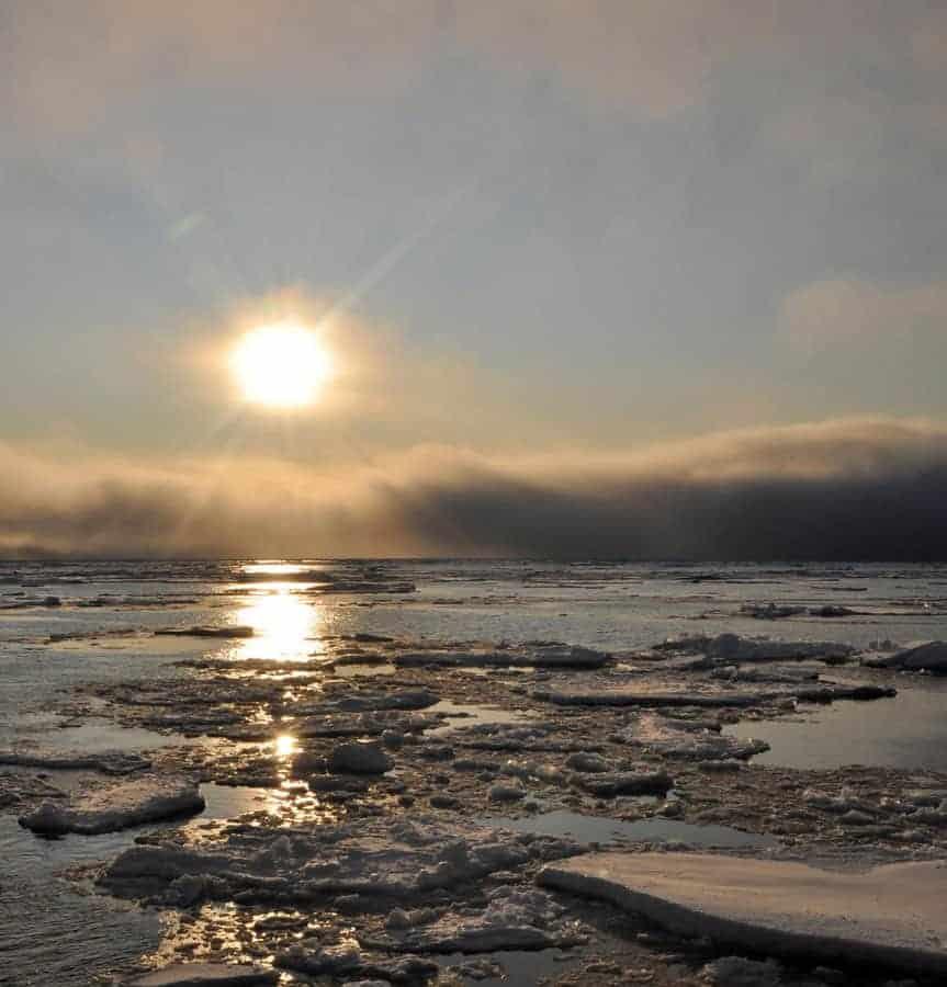 The sun hovers just above the Arctic Ocean horizon Sept. 9, 2009. Photo: Patrick Kelley, U.S. Coast Guard. Public domain.