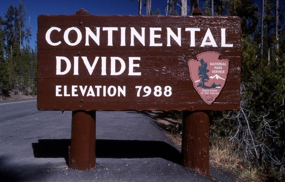 A sign marking the location of the North American Continental Divide in Yellowstone National Park. Photo: NPS, public domain.