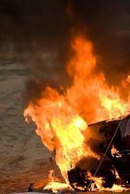 Car Safety Investigation - Tesla Model S Sedan Fires Spark Federal Investigation