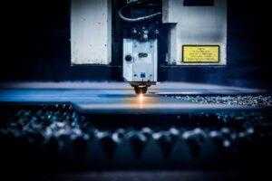 closeup of a plasma laser cutter CNC machine
