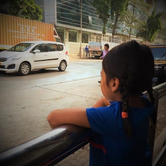 girl looking at street, teaching girls about travel