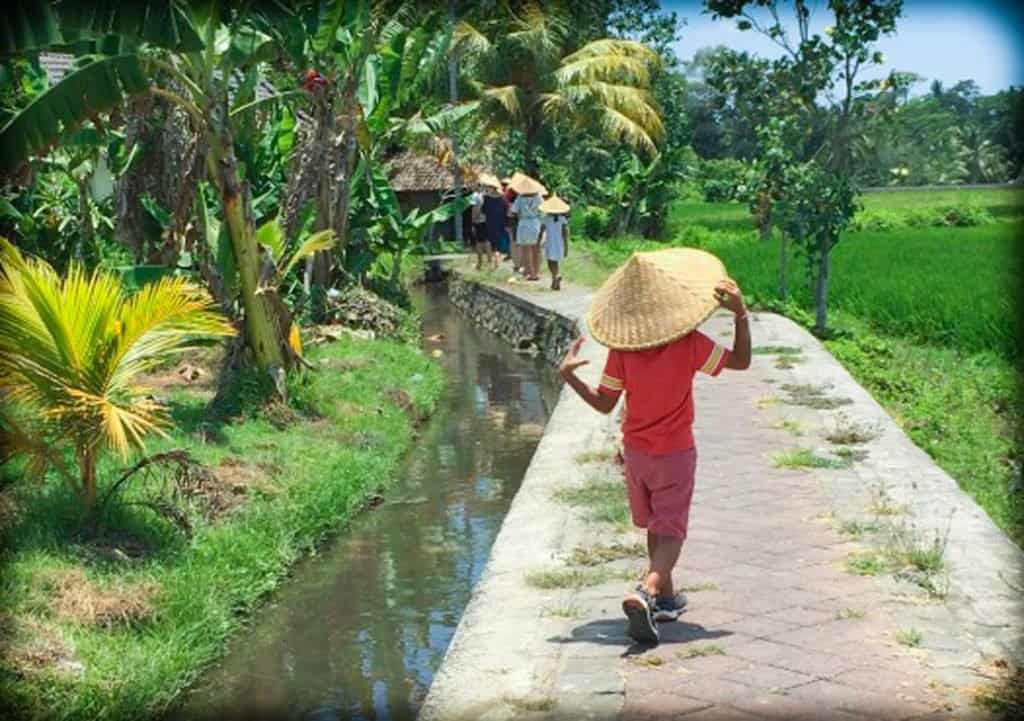 A child on a tour in Bali, Indonesia geared towards sustainable and responsible tourism