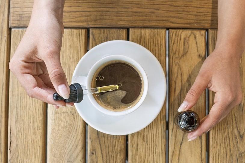 Adding CBD oil to coffee