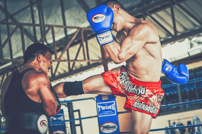 muay thai fighter with coach