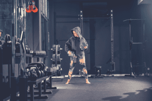 woman boxer in gym with weights