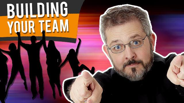 dave curlee enthusiastically pointing forward toward you. White text reads Building Your Team on top of black and orange background with a silhouette of people jumping up in the air happily