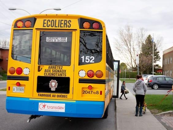 A school bus arrives carrying one student in May 2020.