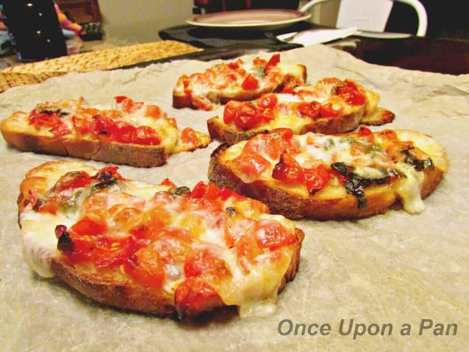 Baked tomato and mozzarella bruschetta image