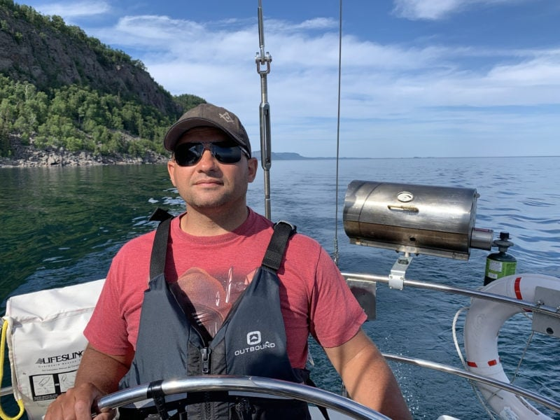 Male at the Helm of Frodo on Lake Superior