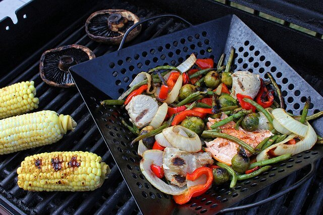A grill basket keeps your veggies from slipping through the cracks!