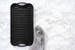 Cast iron griddle on a marble background