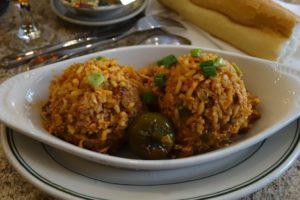 jambalaya served elegantly in white casserole dish