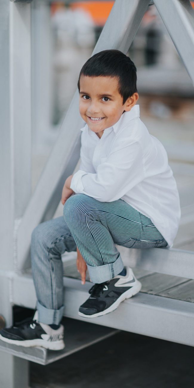 kid smiling at photoshoot - real and natural photos of your family in melbourne - clean and white styling