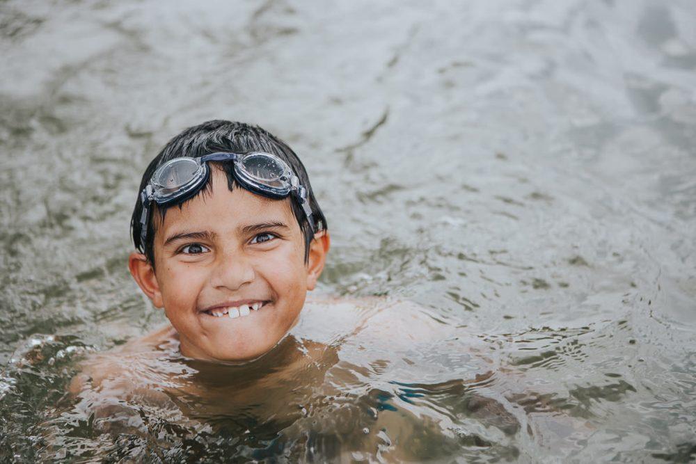 kid swimming in ocean - family photographer