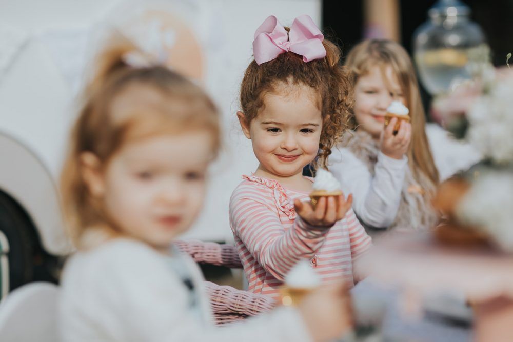 kids enjoying cupcakes at birthday party - high tea for kids - fun photoshoots for birthday parties