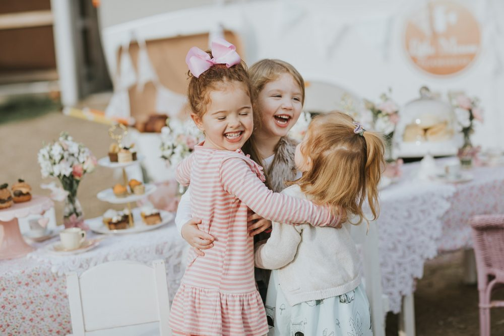 kids hugging at party - high tea for little kids p- capturing emotion and fun