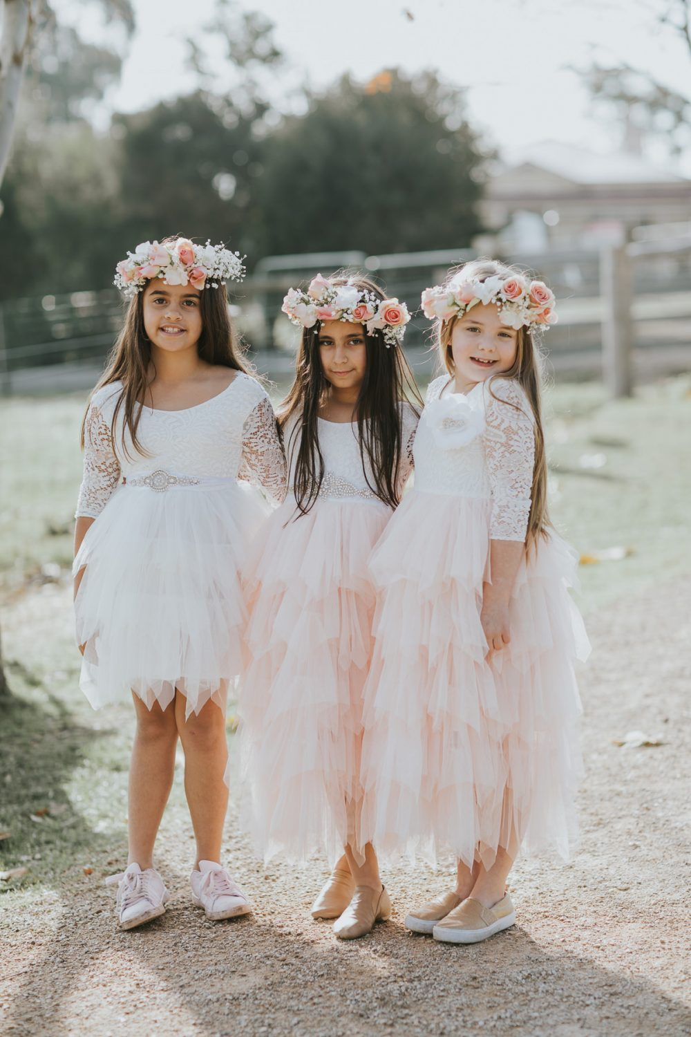 three girls in white dresses and flower crowns