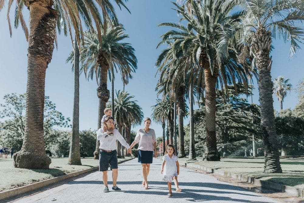 walking through the park with your family - natural family photos at Brighton Park