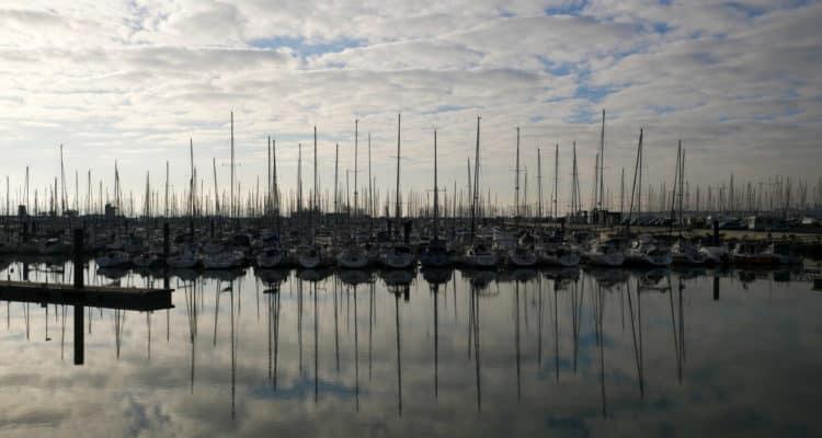 Reflection of boats in the water in La Rochelle, France