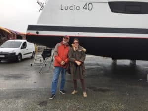 Barry and Mary Ann standing in front of a Lucia 40 Fountaine Pajot