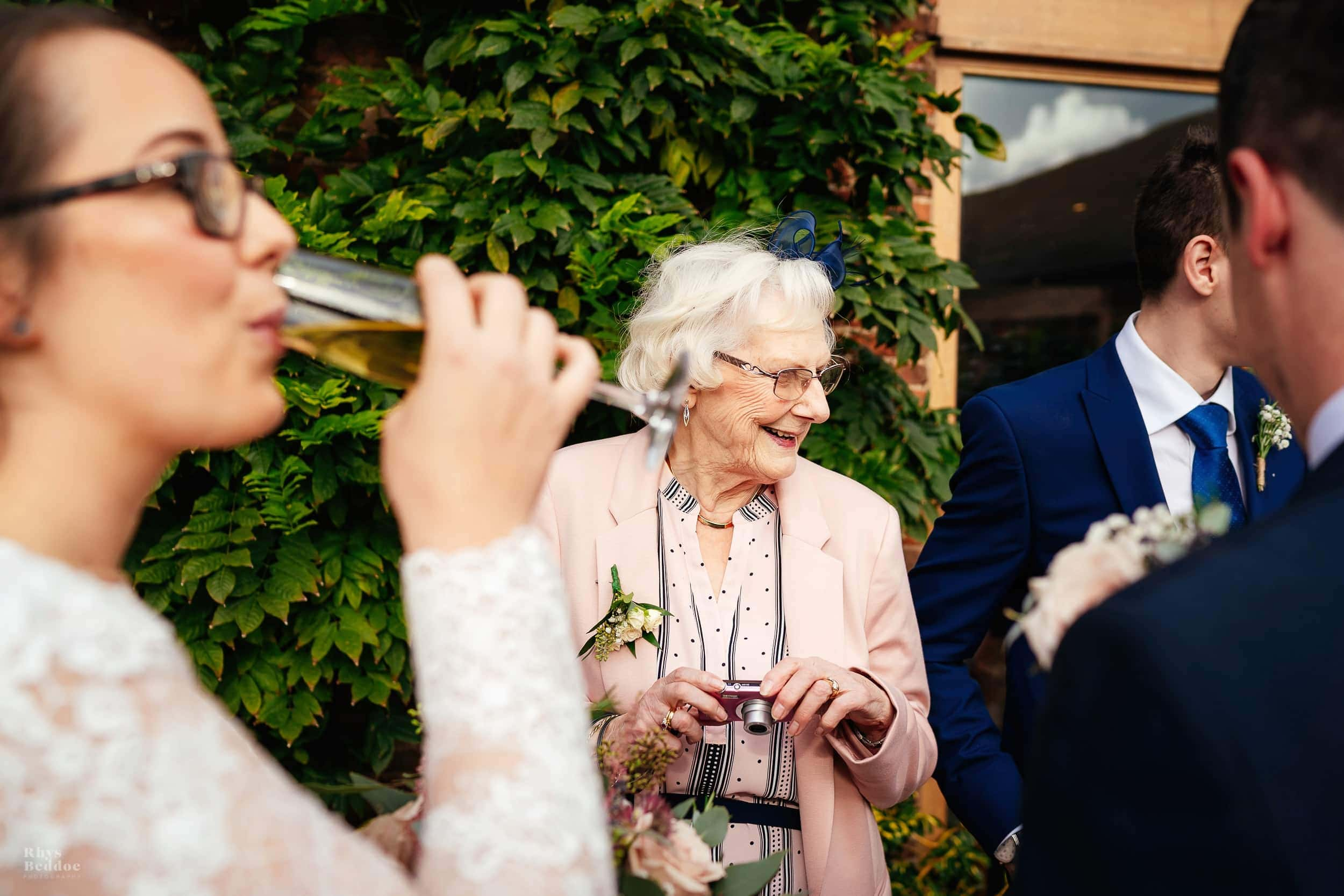 guests laughing in the sun photographer by mythe barn wedding photographer