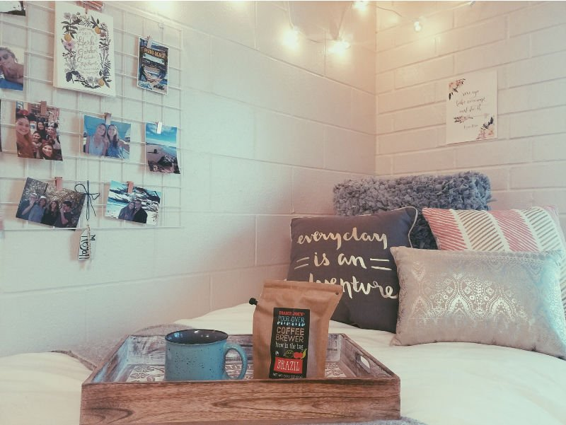 cute dorm bed with throw pillows, photo grid