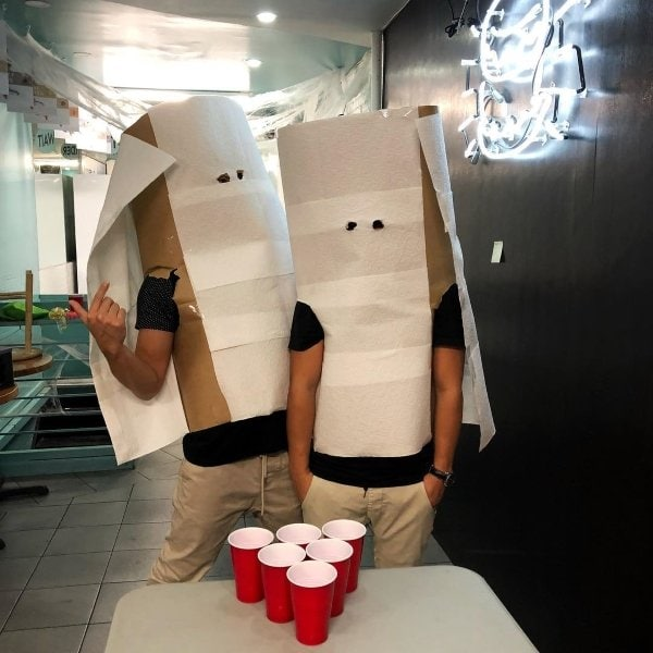 two guys wearing toilet paper roll costumes
