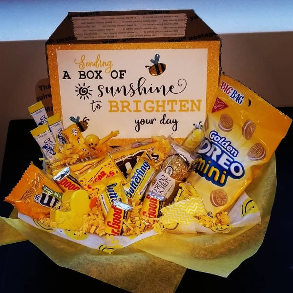 cheerful gift basket with lots of yellow candies and a card
